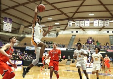 TRIBUNE PHOTO: JAIME VALDEZ - Marcus Tsohonis of Jefferson High goes to the basket Friday against Beaverton as the Democrats win at Chiles Center and reach the Class 6A championship round.