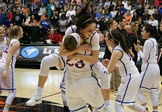 PAMPLIN MEDIA GROUP: JIM BESEDA - La Salle Prep's Aleah Goodman jumps into the arms of Kylie Burg (23) after Friday's 44-26 win over Silverton.