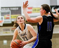 NEWS-TIMES PHOTO: CHASE ALLGOOD - Banks' Anna Klein prepares to go up for a shot during the Braves game versus Sutherlin.