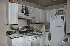 SUBMITTED PHOTO: LAKE OSWEGO FIRE DEPARTMENT - Lake Oswego Fire Department officials estimate the damage to a stove and surrounding cabinets at roughly $7,000-$8,000 after a Monday-afternoon fire at the Kruseway Commons apartment complex.
