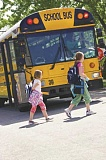 REVIEW FILE PHOTO - Lake Oswego School District students file past a bus.