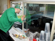 GARY ALLEN - Local native Matt Clay serves a customer at the drive-up coffee stand Local Roots Coffee, 109 N. Highway 99W, which he opened last month with business partner Mark Jordan with plans of serving affordable, quality coffee to their neighbors.