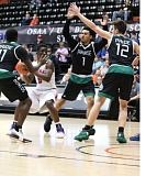 PAMPLIN MEDIA GROUP: JIM BESEDA - Isaac Bonton (1) and Parkrose High teammates NaShawn Penney (left) and Thomas Grant defend La Salle Prep's Ange Toku in the Class 5A third-place game at Gill Coliseum.