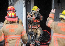 OUTLOOK PHOTO: JOSH KULLA - Gresham Fire Department firefighters work the scene of a residential fire this morning at a triplex at 805 NE Fifth Street.
