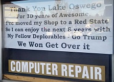 REVIEW PHOTO - A sign in the window of Kevin 'The Geek' Kerwin's computer repair store announces that he is leaving Lake Oswego to set up shop in a Red State.