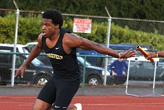 TRIBUNE PHOTO: JONATHAN HOUSE - Jabril Parks of Roosevelt High takes the hand-off for the anchor leg of the 4x400-meter relay during a three-way meet last week at Wilson.