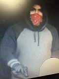 OCPD - The suspect in the Dotty's robbery is seen with a handgun in this photo.