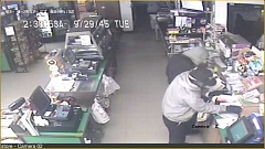 COURTESY MCSO - The two suspects are pictured in security camera footage.
