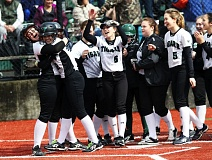 DAN BROOD - Tigard High School sophomore Sara Moss (second from left) is congratulated by her teammates after hitting a home run during the Tigers' 3-0 win over McNary on Monday.