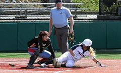 REVIEW PHOTO: MILES VANCE - Lake Oswego's Marin Penney slides safely into home during her team's 14-3 win over Madison in the Glencoe Spring Break Softball Tournament at the Gordon Faber Recreation Complex in Hillsboro on Friday.