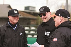 PHIL HAWKINS - Woodburn baseball head coach Craig Webster (left) faced off against younger brother and Gladstone head coach Casey Webster (right) last week in a non-conference game officiated by umpire and middle brother Carey (middle) on March 28 at North Marion High School. Casey and the Gladiators got the best of Craig and the Bulldogs, rallying for a 7-6 victory in extra innings.