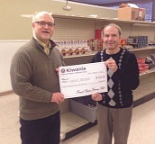 COURTESY PHOTO - French Prairie Kiwanis President Steve Kufeldt (left) presents Wilbur Kauffman, director of the AWARE Food Bank, with a check for $804.50.