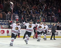 TRIBUNE PHOTO: JONATHAN HOUSE - The Portland Winterhawks celebrate one of their four playoff victories against the Prince George Cougars.