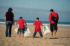 COURTESY SOLVE - A family scours the beach for litter during a past SOLVE cleanup on the Oregon Coast.
