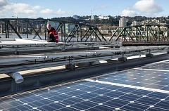 TRIBUNE: JONATHAN HOUSE - Solar panels are installed atop a Portland fire station.