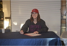 SPOKESMAN PHOTO: COREY BUCHANAN - Wilsonville High senior Kristen Burke recently signed her letter of intent to compete for the Linfield soccer and track and field teams next year.