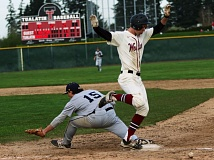 DAN BROOD  - Tualatin junior Chris Freese (right) is safe at first base in Monday's game.