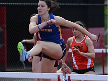 OUTLOOK PHOTO: DAVID BALL - Barlow senior Renick Meyer led start-to-finish in the high hurdles and also scored first-place points in the 100-meter dash and the 400 relay at the Sandy Invitational on Saturday.