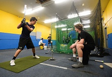 OUTLOOK PHOTO: JOSH KULLA - Members of the Barlow High baseball team go through drills in their indoor facility adjacent to their campus field. Rain has limited teams to only a handful of outdoor practices through the first month of the season.