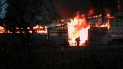 RON ALLEN - Firefighters from three districts battle the blaze as a home and barn were engulfed by fire Sunday evening.
